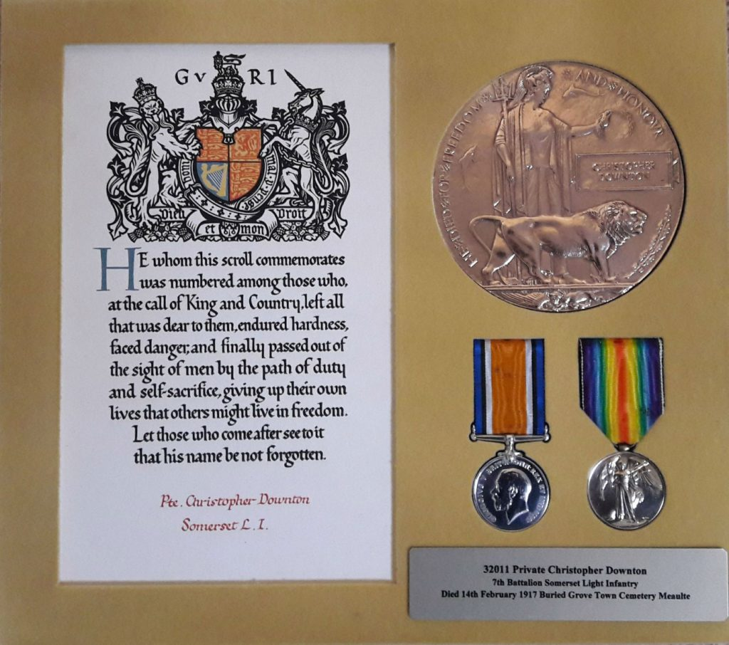 Christopher's Medals and Memorial Plaque